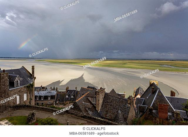 Mont Saint Michel, Normandy, France, A view of bay with rainbow and abbey's shadow
