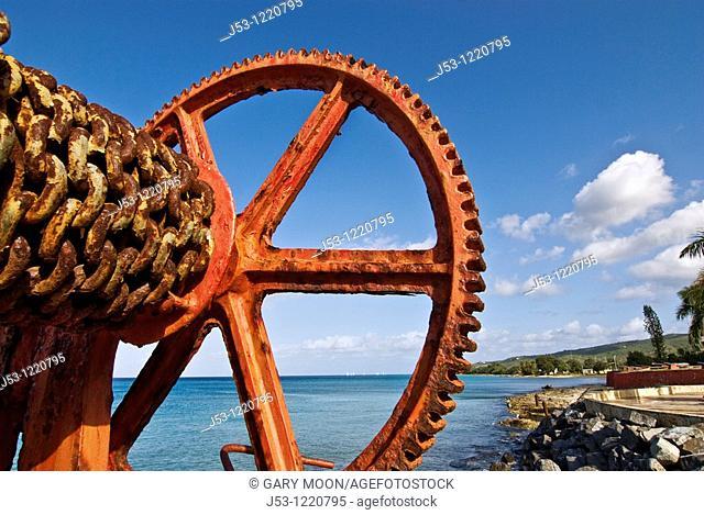 Old rusty derrick at shoreline, Frederiksted, St Croix, US Virgin Islands