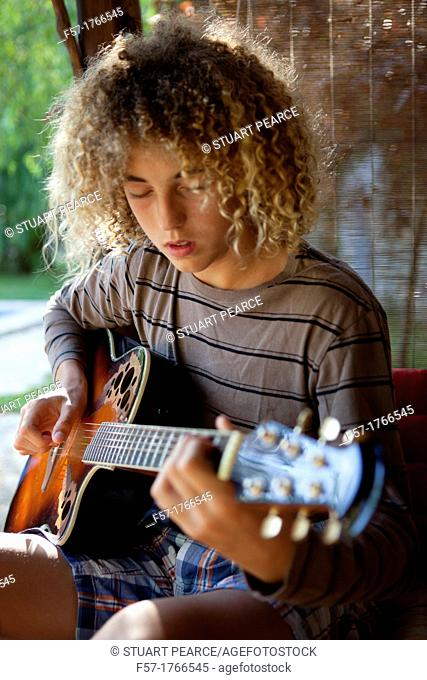 Teenage musician with his guitar