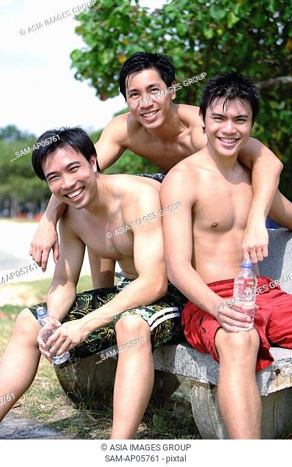 Three men without shirts, looking at camera