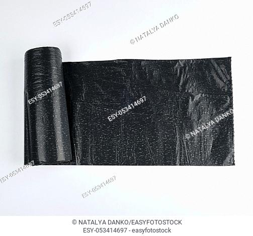 roll black plastic bag for garbage on a white background, top view