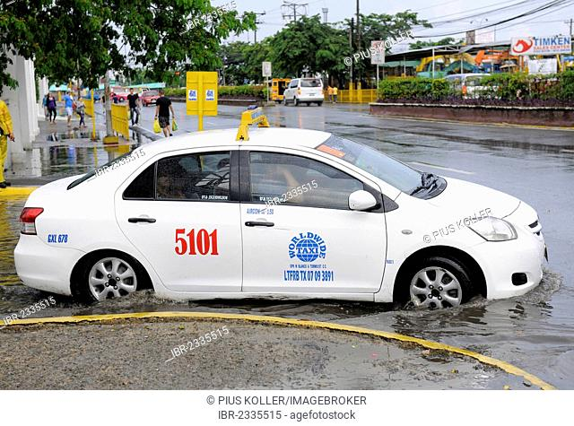 Car in a flood, Cebu, Philippines, Southeast Asia, Asia
