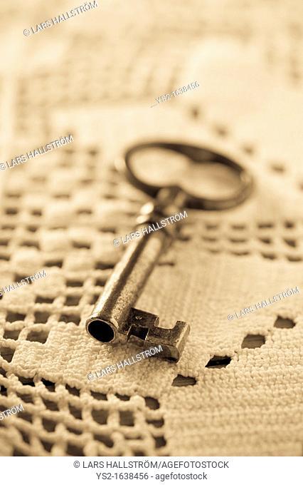 Key lying on tablecloth