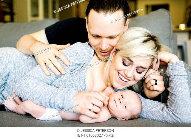 Portrait of parents with newborn boy ( 0-1 months )