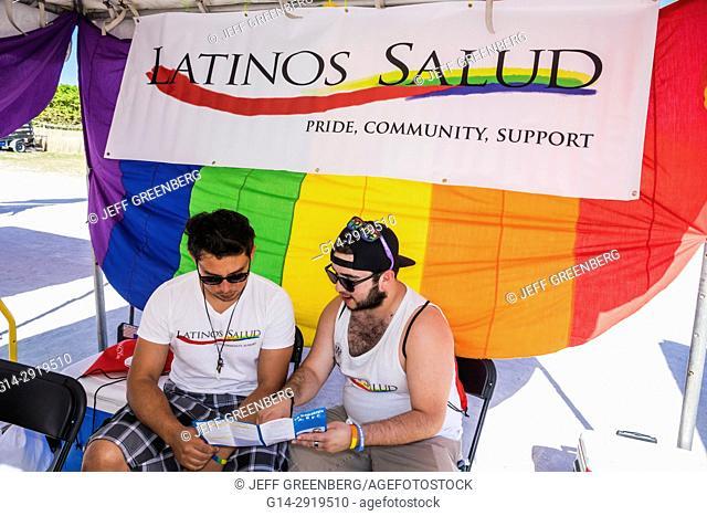 Florida, Miami Beach, Lummus Park, Gay Pride Week, LGBTQ, LGBT, Hispanic, man, information booth, Miami Beach Pride Festival