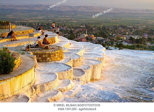 Travertine terrace formations and tourists  Pamukkale  Denizli province  Anatolia  Turkey