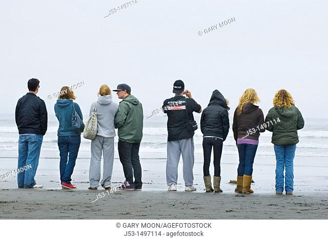 Young adults watching surfing competition, Crescent City, California