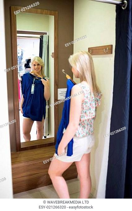 Woman standing in front of a mirror in the changing room