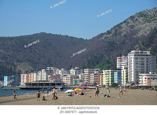 the beach with visitors and appartmentbuildings of Lezhe in background, Albania