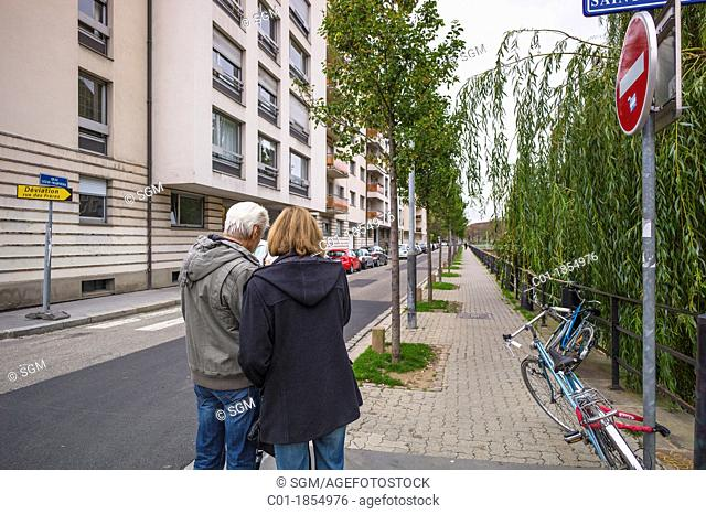 Couple looking at city map Strasbourg Alsace France