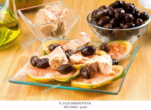 Homemade tomato salad with olives and marinated tuna