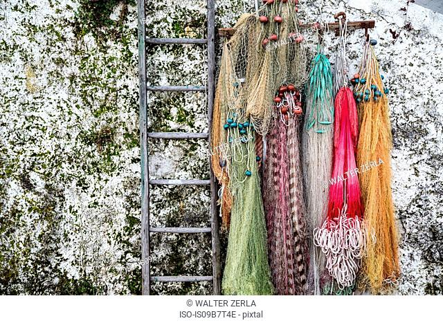 Fishing nets hanging from wall at Isola Pescatori, Lake Maggiore Piedmont, Italy