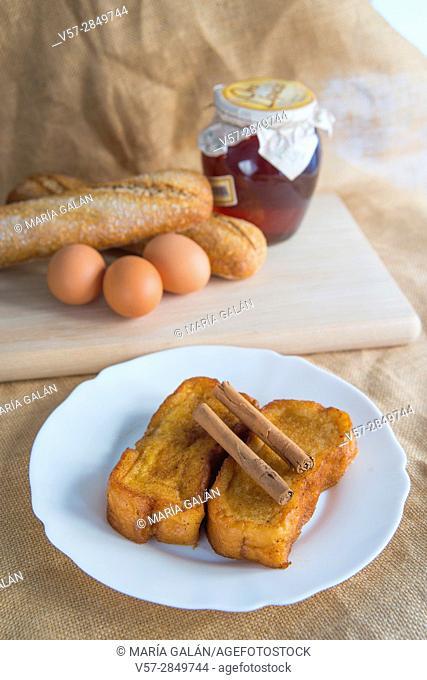 Torrijas, traditional Spanish Easter dessert, with some ingredients. Spain