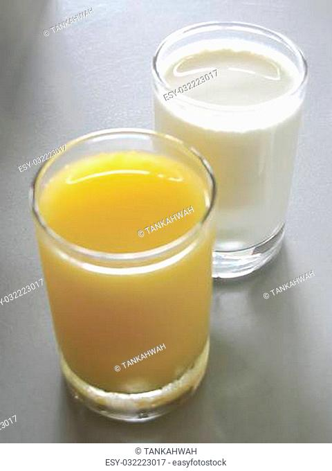 Orange juice and milk at the breakfast table