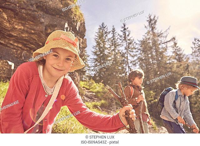Three children exploring forest