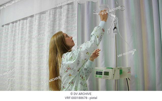 A nurse prepares IV equipment
