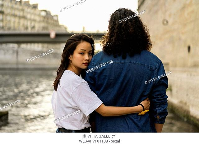 France, Paris, young couple in love at river Seine