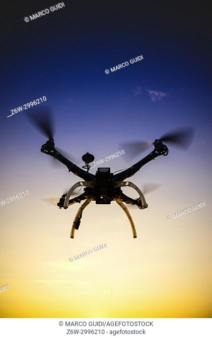 Photographic representation of the flight of a quadrocopter at sunset