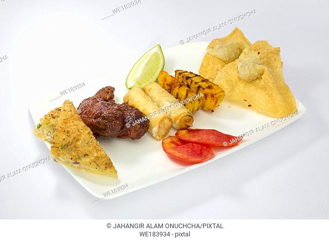Indian Style and Thai style mixed Fusion food platter. Fusion cuisine is cuisine that combines elements of different culinary traditions