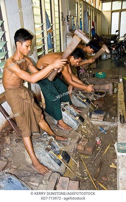 Myanmar (Burma) Mandalay 'King Galon Gold Leaf Factory' Men beating gold into leaf