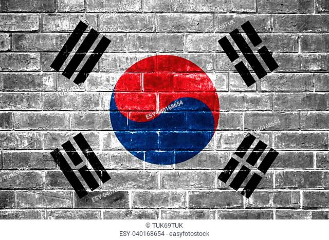 An image of the South Korea flag painted on a brick wall in an urban location