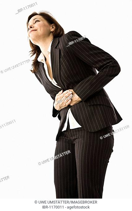 Businesswoman with stomach pains