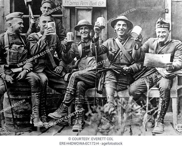 World War I, American soldiers in the Bois de Nonsard section holding empty beer steins left by the retreating German troops, 19