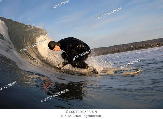 Man surfing, South-central Alaska; Homer, Alaska, United States of America