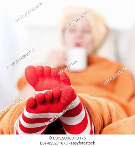 women wearing funny toesocks at home