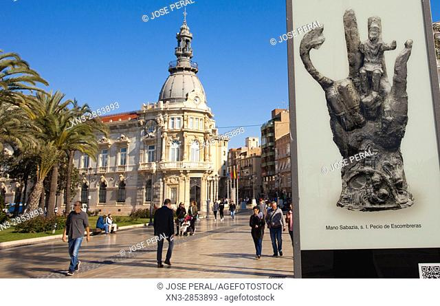 On background Tourist office in the Town Hall, Poster announcer of Escombreras Wreck Hand Sabazia, Mano Sabazia de S.I del pecio de Escombreras