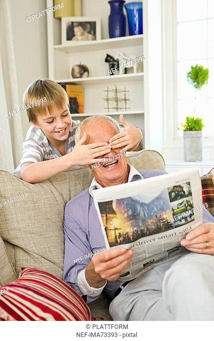 Grandfather and grandson in a sofa, Sweden
