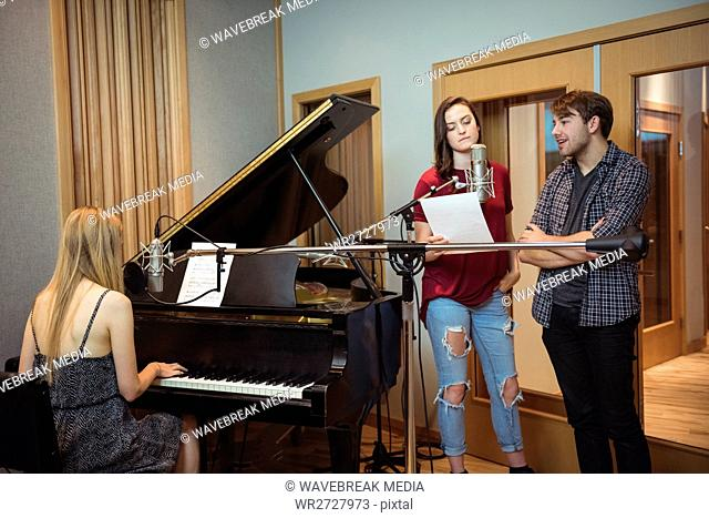 Musician recording a song