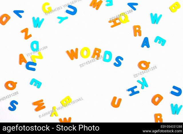 Colorful letters and letters spelled Word learning on white background, learning or study concept various colors