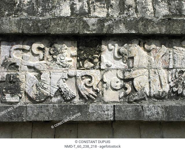 Carvings on the stone wall of a temple, Temple Of Warriors, Chichen Itza, Yucatan, Mexico
