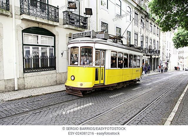 Old tram in Lisbon, detail of an old public transport, tourism