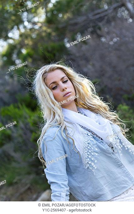 Beautiful blonde countrygirl n denim shirt waist-up shot