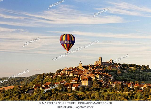View of the Basilica of Sainte Marie-Madeleine, advertising for a music festival on a hot air balloon, Vezelay, Burgundy region, department of Yonne, France