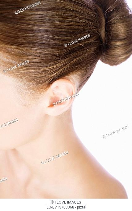 A young woman's ear, close-up
