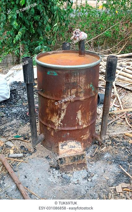 Garden incinerator bin burning waste from the garden