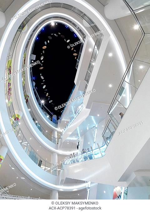 Abstract architectural photo of escalators and multiple levels of Diver City shopping complex in Odaiba, Tokyo, Japan