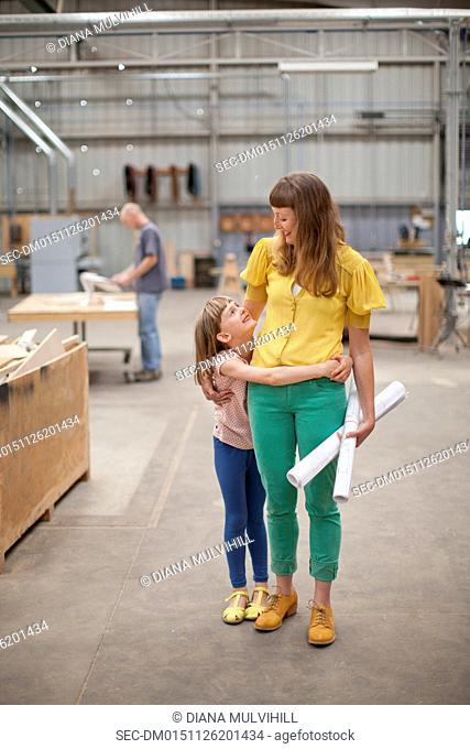 Female architect with daughter (6-7) in workplace