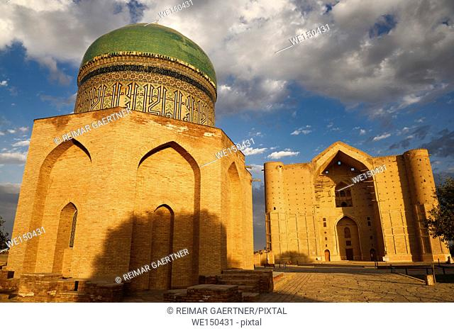 Mausoleums of Rabigha Sultan Begum with dome and Khoja Ahmed Yasawi at dawn in Turkestan Kazakhstan