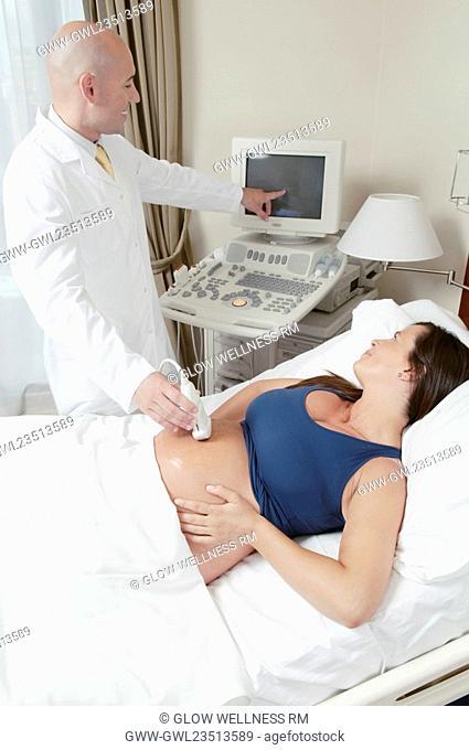 Pregnant woman going through an ultrasound scan