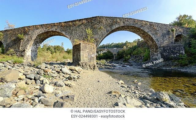 medieval bridge over Orba river near santa Maria alla Croce Cistercian abbey, Tiglieto, Ligure inland, Italy
