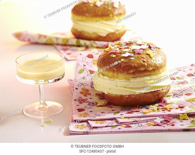 A glazed carnival doughnut filled with eggnog cream