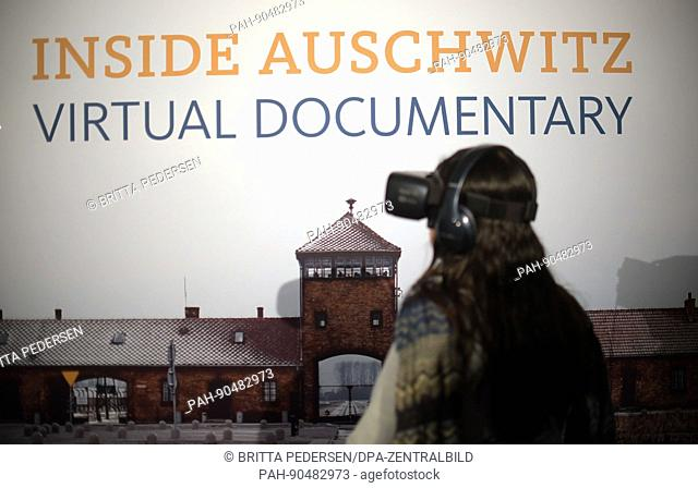 """A young woman looks through a pair of virtual reality glasses at the labore:tory, where """"""""Inside Auschwitz - Virtual Documentary"""""""" can be seen at the internet..."""