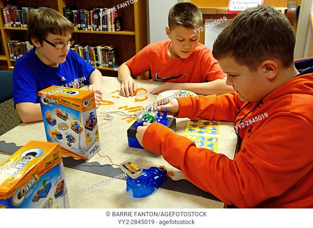 6th Grade Boys Working With Circuits, Wellsville, New York, USA