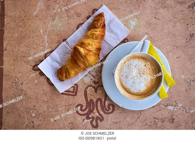 Cup of coffee, croissant