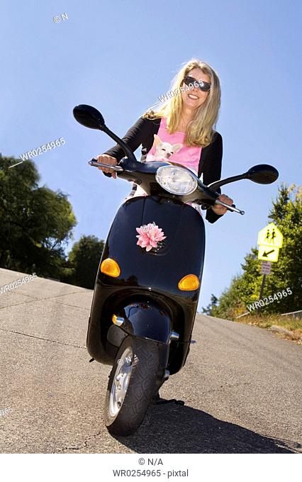 Woman dog scooter Stock Photos and Images | age fotostock