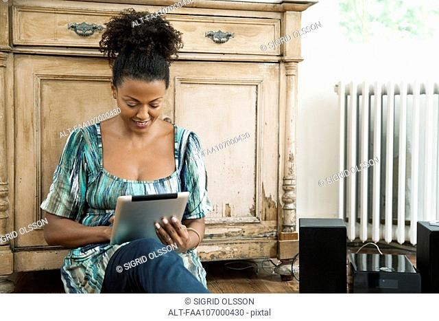 Woman reading e-book on digital tablet